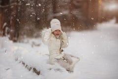 Sweet beautiful girl enjoying falling snowflakes in the park for walk. Sweet beautiful girl enjoying falling snowflakes in the park for a walk royalty free stock photos