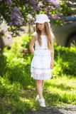 Sweet beautiful 7 year old girl posing on a sunny summer day Royalty Free Stock Photography