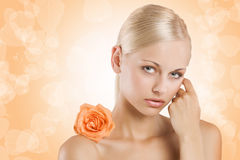 Sweet beauty girl on orange Stock Image