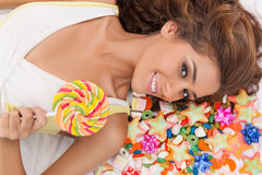 Sweet beauty. Top view of beautiful young women holding a lollip Royalty Free Stock Image