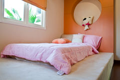 Sweet bedroom. Sweet orange bedroom with pink bed Stock Images