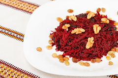 Sweet beetroot salad with prunes, raisins and walnut Stock Photography