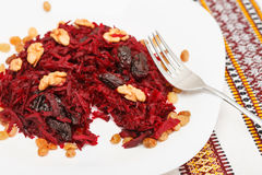 Sweet beetroot salad with prunes, raisins and walnut Royalty Free Stock Photography
