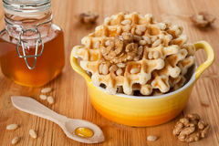 Sweet Belgian waffles with honey and nuts for a ta Stock Photo