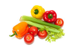 Sweet bell peppers, tomatoes and celery on a white background Royalty Free Stock Photography