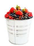 Sweet berries in bucket. Sweet berries of Blueberry, strawberry, raspberry, black and red currant in  bucket Royalty Free Stock Images