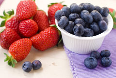 Sweet berry. Sweet bilberry and strawberry from forest Royalty Free Stock Images