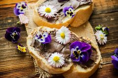 Sweet berry bruschetta with chocolate nut butter,mint and sliced almonds on the white vintage dish royalty free stock photos