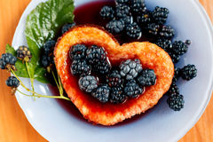 Sweet berry omelet with blackberry. Close-up Royalty Free Stock Photo