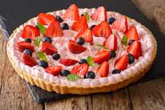 Sweet berry tart with whipped cream, strawberries and blueberrie Stock Photography