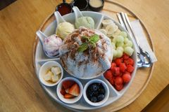 Sweet bingsu korean desert with fruits, melon, strawberries, blueberries, watermelon, icecream stock photo