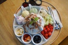 Sweet bingsu korean desert with fruits, melon, strawberries, blueberries, watermelon, icecream royalty free stock images