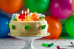 Sweet birthday cake with candles Stock Images