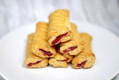 Sweet biscuits with jam on a white plate. On a table Royalty Free Stock Photography