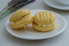 Sweet Biscuits on White Plate. Yo Yo`s or Melting Moments Royalty Free Stock Photography