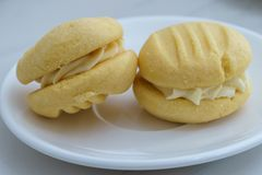 Sweet Biscuits on White Plate. Yo Yo`s or Melting Moments Royalty Free Stock Image