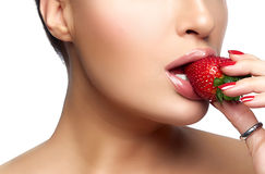 Sweet Bite. Healthy Mouth Biting Strawberry. Sweet bite. Beautiful Healthy mouth biting strawberry. Closeup portrait isolated on white Stock Photos