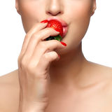 Sweet Bite. Healthy Mouth Biting Strawberry. Sweet bite. Beautiful Healthy mouth biting strawberry. Closeup portrait isolated on white Stock Photo