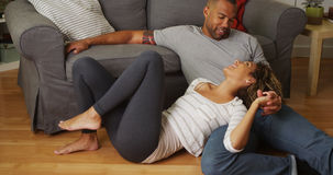 Sweet black couple talking on floor Stock Image