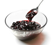 Sweet blackberry jam in the transparent glass bowl with tea spoo Royalty Free Stock Photo
