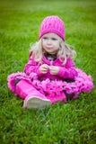 Sweet blodne girl sitting on green grass Stock Photo
