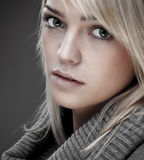 Sweet Blond Girl With Warm Collar. Closeup Of A Sweet Blond Girl With A Big Warm Collar Around Her Neck Stock Photo