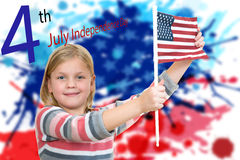 Sweet blonde Girl holding an american flag stock photos