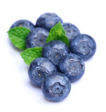 Sweet blueberries with mint leaves Stock Photography