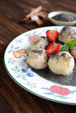 Sweet boiled dumplings filled with strawberries with a poppy seed sauce Royalty Free Stock Photos