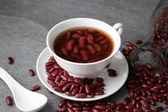 Sweet boiled red beans in white cup on concrete table.  royalty free stock photography