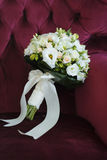 Sweet Bouquet of the Bride in a Chair Stock Images