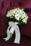 Sweet Bouquet of the Bride in a Chair Royalty Free Stock Image
