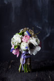 Sweet bouquet on dark old wood and blackboard Stock Photos