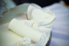 A sweet bow on the cake Stock Images
