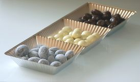 Sweet box. With three kinds hazel nut in chocolate Royalty Free Stock Photos