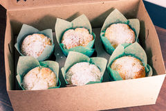 Sweet box with six fresh baked muffins Royalty Free Stock Photos