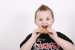 Sweet boy eating food Royalty Free Stock Images