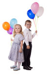 Sweet boy and girl with colorful balloons Royalty Free Stock Photo
