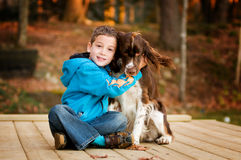 Sweet boy and his dog. Little boy and his pet springer spaniel outdoors on a fall day Stock Image