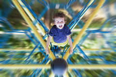 Sweet boy on the playground, hanging upside down Royalty Free Stock Photos