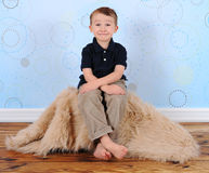 Sweet boy posing with a silly grin Royalty Free Stock Photos
