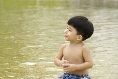 Sweet  boy in water Royalty Free Stock Image