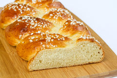 Sweet braided bread on a plate Royalty Free Stock Photos