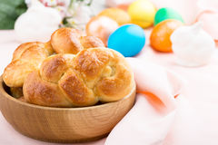 Sweet braided yeast bread. Homemade sweet braided yeast bread on easter table background royalty free stock photo