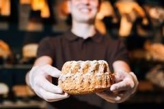 Sweet bread. Baker selling tasty sweet bread Royalty Free Stock Photos