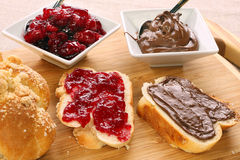 Sweet bread breakfast with jam and chocolate cream Stock Images
