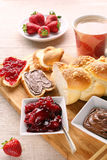 Sweet bread breakfast with strawberry jam and chocolate Royalty Free Stock Photos