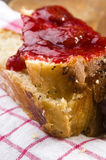 Sweet bread (challah) with strawberry jam Royalty Free Stock Images