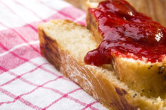 Sweet bread (challah) with strawberry jam Royalty Free Stock Photo