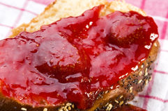 Sweet bread (challah) with strawberry jam Stock Photography